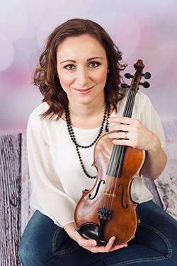 učiteľka hry na husliach